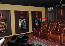 Sandy Utah Basement finish picture of theater room showing movie posters and theater seating