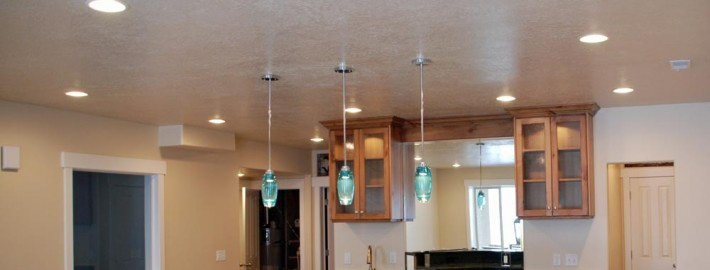 photos of basement lighting- can lights and pendant lights